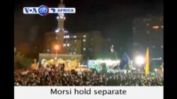 Supporters and opponents of President Morsi hold separate rallies in Cairo.