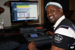 Madlingozi mixing new music in his Johannesburg studio