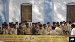 Indian policemen stand guard at Ahmedabad Central Jail, as a special court announces the verdict on a 2002 train burning case in Ahmadabad, India, February 22, 2011