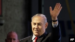 FILE - Israeli Prime Minister Benjamin Netanyahu waves during the opening ceremony for a bomb-proof emergency room in a hospital in Ashkelon, Israel, Feb. 20, 2018.