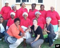 Lucy O' Keeffe [front, right], Kwandwe's human development specialist, with some of the women she works with to uplift poor local people who live in and on the fringes of game reserves in South Africa's Eastern Cape province