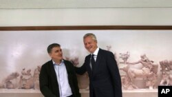 French Minister of the Economy and Finance Bruno Le Maire , right, meets with his Greek Finance Minister Euclid Tsakalotos in Athens, June 12, 2017. Their meetings in Athens are aimed at ending a months-long delay in a rescue funding agreement between Greece and bailout lenders