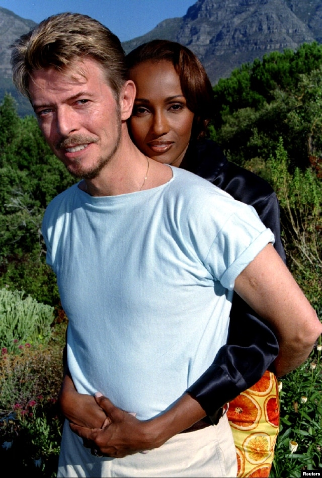 Pop star David Bowie and his super model wife Iman pose for photographs during a visit to Cape Town, February 25.