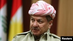 FILE - Kurdistan Regional Government President Masoud Barzani speaks during an interview in Arbil, in Iraq's Kurdistan region, May 12, 2014.