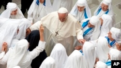Pope Francis is greeted by a group of nuns during his weekly general audience in the Pope Paul VI hall at the Vatican, Wednesday, Aug. 22, 2018. (AP Photo/Andrew Medichini)