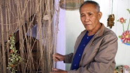 Boonrian Chinnarat holds a net he once used to catch giant catfish at his house in Chiang Kong district of Chiang Rai province, northern Thailand, Feb. 7, 2011. He blames the disappearance of the fish partly on China's upstream dams.