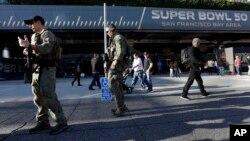 Members of the FBI SWAT team keep watch inside the NFL Experience, Feb. 2, 2016, in San Francisco.