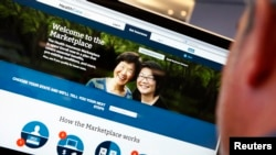 FILE - A man looks over the Affordable Care Act (commonly known as Obamacare) signup page on the HealthCare.gov website.