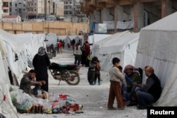 Internally displaced Syrians are seen in an IDP camp in Idlib, Syria, Feb. 27, 2020.
