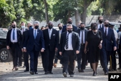 U.S. officials including Rep. Jeff Fortenberry (R-NE), 2nd L, Congressman Gregory W. Meeks (D-NY), 3rd L, and Linda Thomas-Greenfield, 2nd R, U.S. ambassador to the United Nations, arrive for for the funeral of slain President Jovenel Moïse.