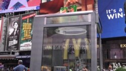 Times Square Phone Booth Art Documents Immigrants' Stories of Their Arrivals