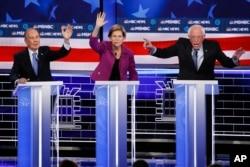 From left, Democratic presidential candidates, former New York City Mayor Mike Bloomberg, Sen. Elizabeth Warren, D-Mass., Sen. Bernie Sanders, I-Vt., participate in a Democratic presidential primary debate, Feb. 19, 2020, in Las Vegas.