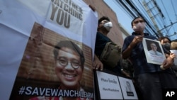 Activists hold photos of Thai dissident Wanchalearm Satsaksit gather for a rally in front of Cambodian Embassy in Bangkok, Thailand, Monday, June 8, 2020. Wanchalearm, has been abducted in Phnom Penh, Cambodia, a human rights group said Friday,…