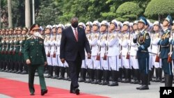 U.S. Secretary of Defense Lloyd Austin with Vietnamese Defense Minister Phan Van Giang, left, inspects an honor guard in Hanoi, Vietnam, Thursday, July 29, 2021. Austin is seeking to bolster ties with Vietnam, one of the Southeast Asian nations…