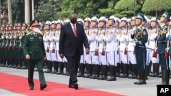 U.S. Secretary of Defense Lloyd Austin with Vietnamese Defense Minister Phan Van Giang, left, inspects an honor guard in Hanoi, Vietnam, Thursday, July 29, 2021.