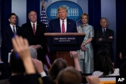 President Donald Trump speaks during a coronavirus task force briefing at the White House, March 20, 2020.