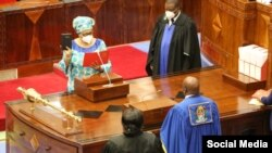 The Speaker of the National Assembly, Job Ndugai, swears in Stergomena Tax as a member of Tanzania's parliament, Sept. 10, 2021. Tax was subsequently appointed defense minister. (Twitter @Hakingowi)
