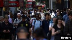 FILE PHOTO: People walk along Oxford Street, amid the coronavirus disease (COVID-19) outbreak, in London, Britain, July 26, 2021.