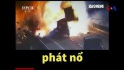 Xe tải Trung Quốc nổ tung trên quốc lộ