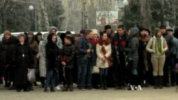 Ukrainian City Honors Rocket Attack Victims as Shaky Cease-Fire Comes Into Effect