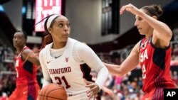 FILE - Stanford guard DiJonai Carrington (21) dribbles as Team USA guard Diana Taurasi, right, defends in the fourth quarter of an exhibition women's basketball game, Nov. 2, 2019, in Stanford, Calif.