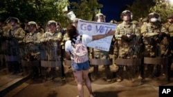 Utah National Guard soldiers stand on a police line as demonstrators gather to protest the death of George Floyd, Thursday, June 4, 2020, near the White House in Washington. Floyd died after being restrained by Minneapolis police officers. (AP Photo…