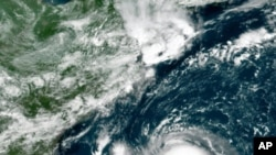 This GOES-16 East GeoColor satellite image taken Friday, Aug. 20, 2021, at 11:40 a.m. EDT., and provided by NOAA, shows Tropical Storm Henri in the Atlantic Ocean.