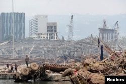 People are pictured at the site of the explosion at the port of Beirut, Lebanon, Aug. 6, 2020.