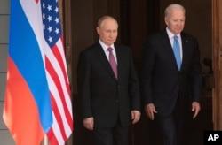 President Joe Biden and Russian President Vladimir Putin, arrive to meet at the 'Villa la Grange', June 16, 2021, in Geneva, Switzerland.