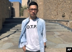 Nathan Law, a Hong Kong democracy activist and current graduate student at Yale, poses on the school campus in New Haven, Conn., Sept. 23, 2019.