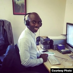 Paris-based Malian journalist Moise Mounkoro works on stories for his new online website. (Courtesy of Moise Mounkoro)