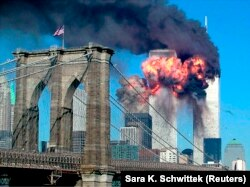 FILE - The second tower of the World Trade Center explodes after being hit by a hijacked airplane in New York, September 11, 2001. (REUTERS/Sara K. Schwittek)