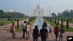A small number of tourists visit as the Taj Mahal monument is reopened after being closed for more than six months due to the coronavirus pandemic in Agra, India, Sept.21, 2020.