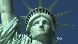 Statue of Liberty Impersonators Welcome Tourists