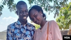 FILE - Sudanese national Ishan Ahmed Abdallah, right, and South Sudanese national Deng Anei Awen are seen in an undated photo. Now, the married couple live in fear of persecution. (Viola Elias/VOA)