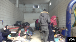 Families trying to cross into Europe camp at this gas station near the Turkish border with Greece, March 18, 2020. (Heather Murdock/VOA)