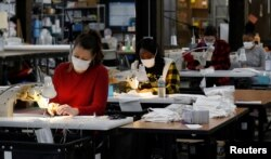 """Jennifer Nagle sews hospital masks as the spread of coronavirus disease continues, on day one of turning the """"Detroit Sewn"""" facility into a production facility for hospital masks, in Pontiac, Michigan, March 23, 2020."""