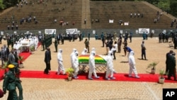 Pallbearers carry the coffin of a government minister, Dr. Ellen Gwaradzimba, who died of COVID-19, at the Heroes Acre in Harare, Jan. 21, 2021. As of Jan. 23, Zimbabwe had lost four Cabinet ministers and several senior officials to the virus.