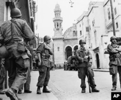 FILE - French troops seal off the historic casbah quarter, in Algiers, Algeria, May 27, 1956.
