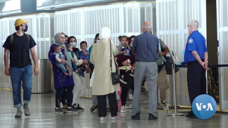 Afghan Evacuees Confused Over Status in US...