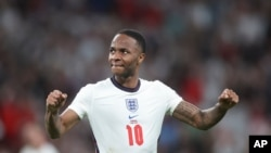 England's Raheem Sterling celebrates a goal during the Euro 2020 soccer championship semifinal match between England and Denmark at Wembley stadium in London, July 7, 2021.