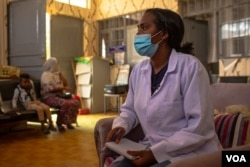 Mihira Redae, a social worker at Ayder Referral Hospital, helps the rape victims to seek treatment for wounds, diseases and psychological trauma, in Mekelle, Ethiopia, June 8, 2021 (Yan Boechat/VOA)