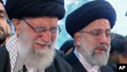 FILE - In this image taken from video, Iranian Supreme Leader Ayatollah Ali Khamenei, left, openly weeps as he leads a prayer over the coffin of Gen. Qassem Soleimani at the Tehran University campus, in Tehran, Iran, Jan. 6, 2020.