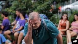 Russ Wilson splashes water on his face from a fountain in New York, July 17, 2019. The heat wave that has been roasting much of the U.S. in recent days is just getting warmed up, with temperatures expected to soar to dangerous levels.