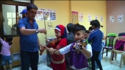 Iraqi Kids Find Refuge in Music