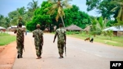 (FILES) In this file photo taken on March 07, 2018 Soldiers from the Mozambican army patrol the streets after security in the area was increased, following a two-day attack from suspected islamists in October last year in Mocimboa da Praia, Mozambique. -…
