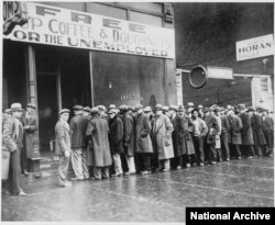 Unemployed men queued outside a depression soup kitchen opened in Chicago, Feburary 1931