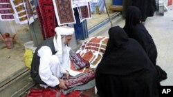 An Iranian man sells traditional embroidered fabric in the Bazaar of the southeastern city of Zahedan, on the border with Afghanistan (file photo)
