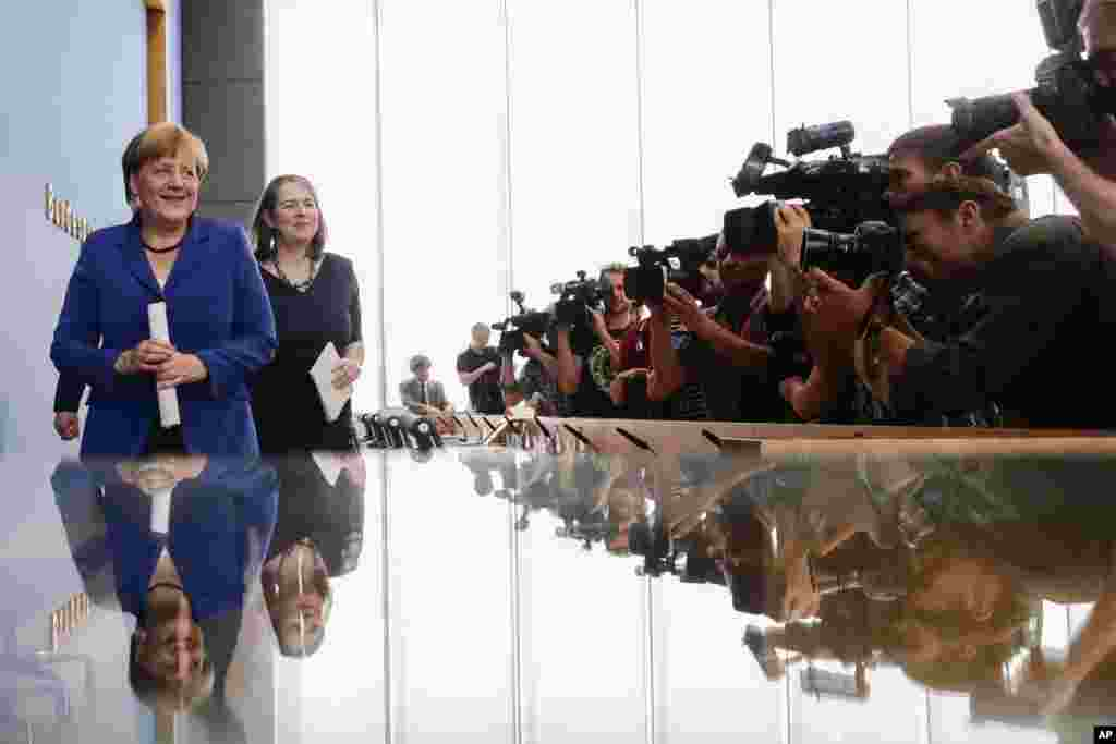 German Chancellor Angela Merkel leaves a news conference in Berlin.