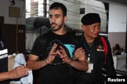 Hakeem AlAraibi, a former member of Bahrain's national soccer team who holds a refugee status in Australia arrives at court after he was arrested on arrival at a Bangkok airport.